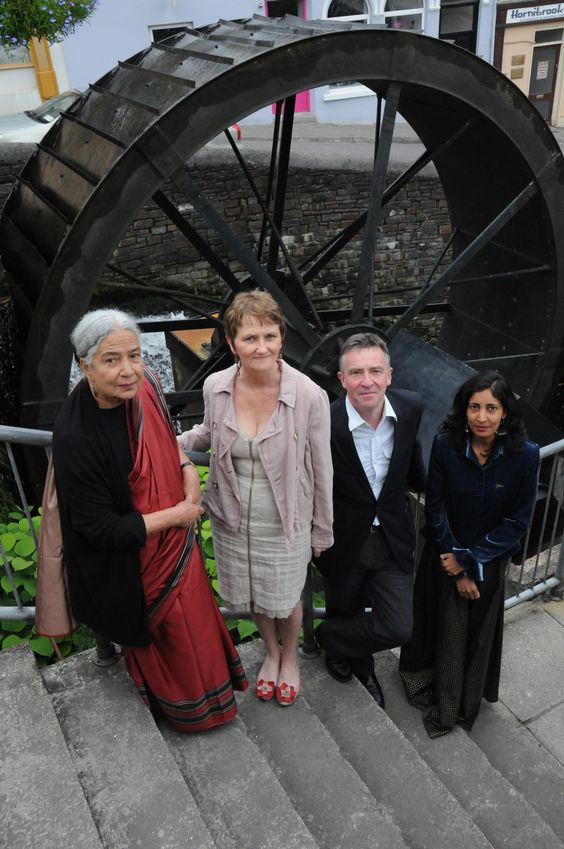 Artistic Director Denyse Woods with writers John McCarthy, Anita and Kiran Desai at the waterwheel outside Bantry Library