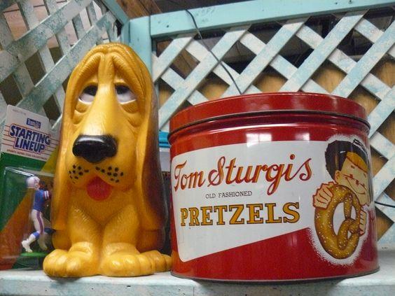 Fun basset hound droppy dog and vintage Sturgis Pretzel snack tin. Scranberry Coop, Andover NJ