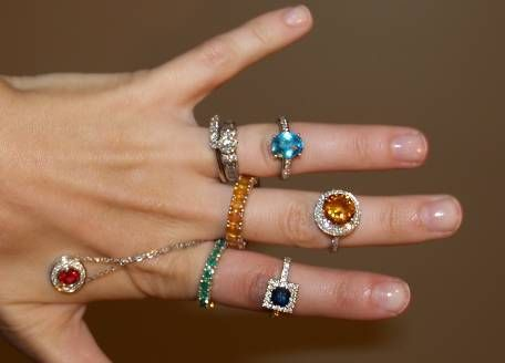 Love the blue topaz ring and the emerald eternity ring.  Make them out of the same stone and wear together?