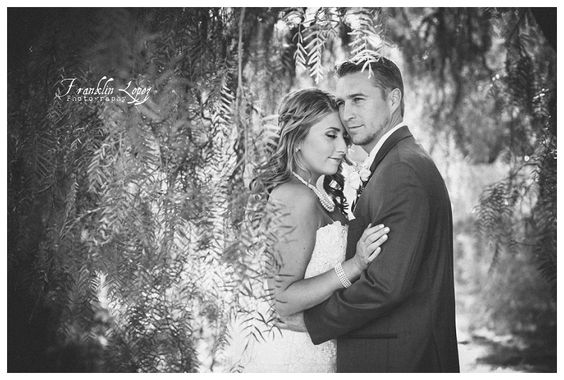 The beautiful bride and groom. Central Coast Weddings. Lace wedding dress. Wedding pearls, wedding jewelry, wedding attire. Franklin Lopez Photography, Eventful Wedding Planning. Hotel Corque located in Solvang, California. Wine Country Wedding. Bridal poses. Beautiful couple. Bridal party poses. Large Bridal party. Mismatched bridesmaids dresses. Bridesmaids flowers. Bridal bouquet. Bride's bouquet.