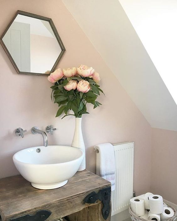 Gorgeous rustic yet feminine bathroom with vessel sink and wall mounted faucet. Pink paint on wall is CALAMINE by Farrow & Ball. Come see the Best Sophisticated, Chic and Subtle Pink Paint Colors on Hello Lovely Studio!