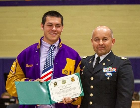 Austin receiving his ROTC scholarship at school his senior year at Saints.