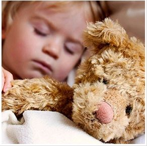 Create a sleep-inducing environment: While a stuffed animal can make it easier for your child sleep, too many toys can make it harder. Soft sheets, room-darkening shades, and relative quiet can help your child differentiate between day and night, making it easier to fall asleep.