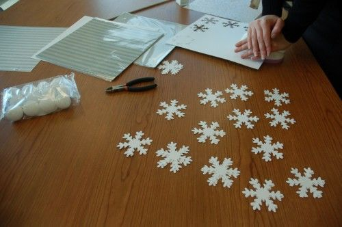 DIY Falling Snowflake Garland | Homes.com for the Holidays