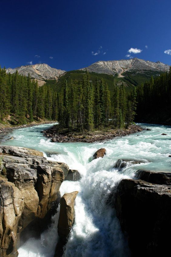 Sunwapta Falls is a waterfall of the Sunwapta River located in Jasper National Park, Canada. It is accessible via a short drive off the Icefields Parkway that connects Jasper and Banff National Parks. The falls have a drop of about 18.5 metres.