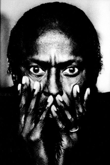 Miles Davis by Anton Corbijn // Montreal, Canada 1985 - Taken in his hotel room with light falling in from the window. In his very large pupils you can actually make out my silhouette. It was a very brief shoot but one of the most satisfying ever. It is also worth noting that this photo was taken well before the TUTU album shoot by Irving Penn and it has become one of my most well- known photographs.