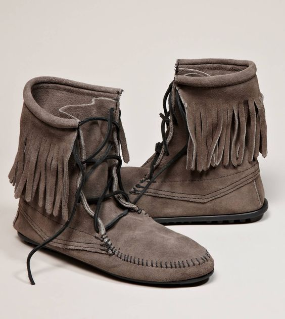 These moccasins are fringed on the back of the bottoms at the soles. The tongues are fringed. The brain tanned leather is in good condition. They look like a era moccasins.