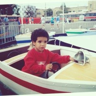 Look at him riding in a fake boat, scared to death about going overboard. | Proof That Drake Was The Cutest Little Boy In The Whole World