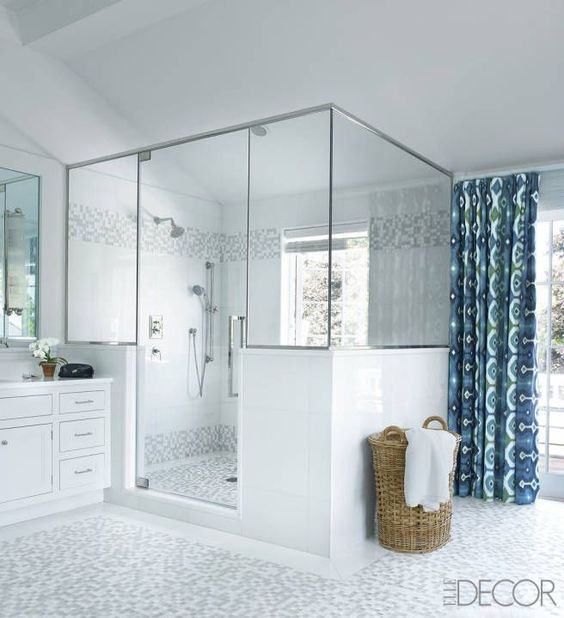 In Jimmy Choo designer Tamara Mellon's Hamptons house, the floor and shower stall in the master bathroom are sheathed with mosaic tiles.   - ELLEDecor.com