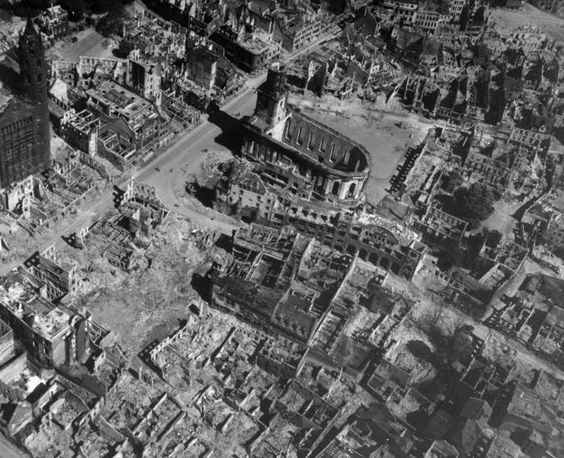 Aerial view of a bomb-damaged churches among the buildings in the center of Worms, Germany, 1945.