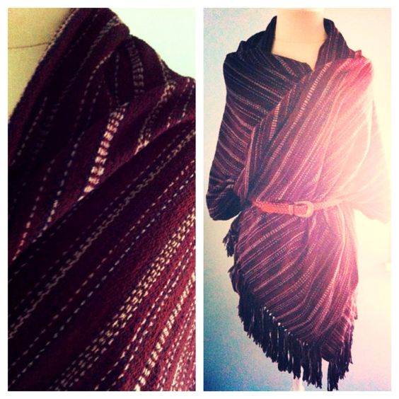 A strong warp stripe of chocolate, merlot, tan and black in this massive rayon scarf brings a northern tone to this South American inspired design.