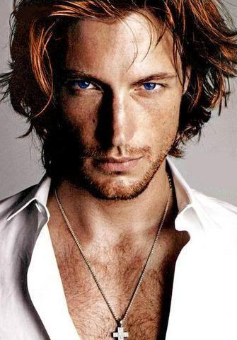Book 3...Adrian. the betrayer..auburn hair bright blue eyes. Hes 481 yrs old