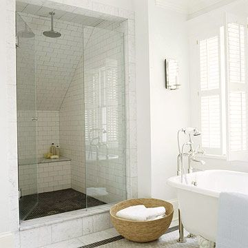 Slanted ceilings can create perfect spaces for built-in showers. The eaves of this house are less visible because the shower camouflages the slope of the roof. The homeowners turned the low-angled ceiling into an advantage by placing a shower seat there -- roomy enough for both the user and of-the-moment supplies.