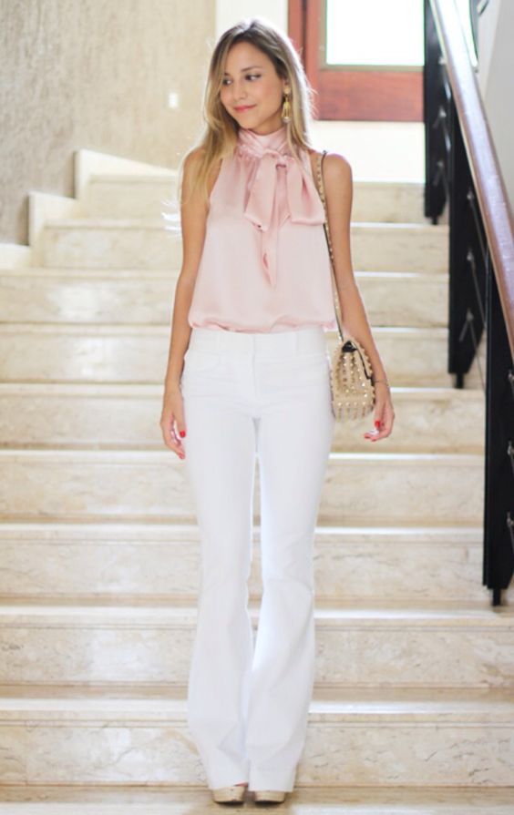 White trousers, pink sleeveless blouse