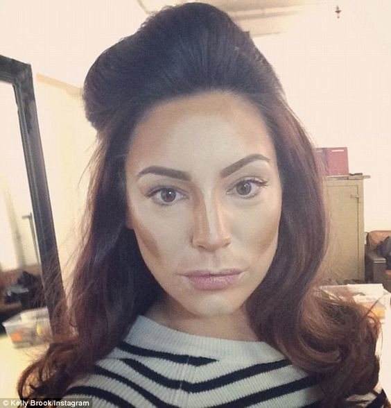 Contouring close-up: Kelly Brook posted a picture of herself mid make-up application on Tu...