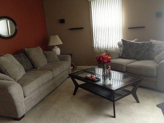 Burnt orange living room spiced orange feature wall - Burnt orange living room ideas ...