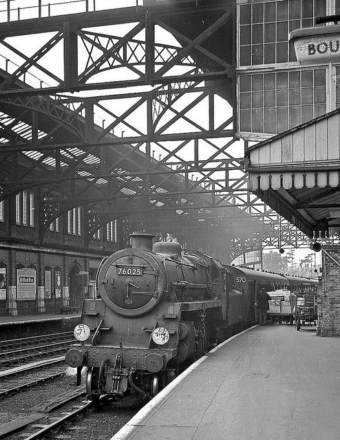 A BR Standard Class 4 is waiting to depart from Bournemouth Central with a local train for Eastleigh. Bournemouth, Dorset, England. Negative scan.