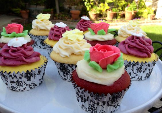 Red Velvet cupcakes with a cream cheese filling and vanilla buttercream  Lemon cupcakes with a blackberry frosting  Vanilla cupcakes with a vanilla pudding and vanilla buttercream   Cupcakes topped with homemade buttercream flowers