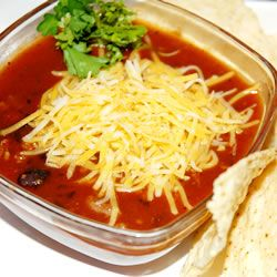 Very good black bean chili recipe. I would add a pinch of sugar, or some other sweetener to this. It mellows and enhances the flavors.