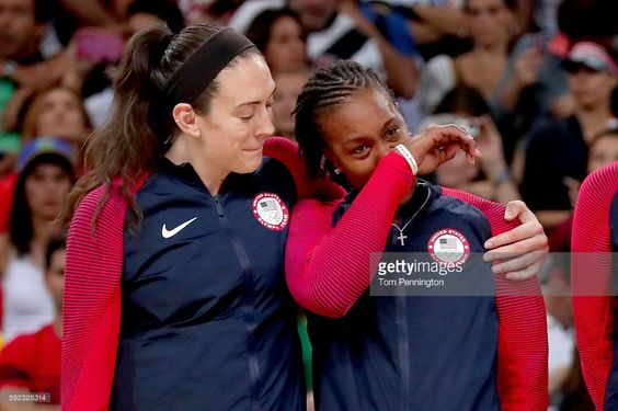 Gold medalists Breanna Stewart #9 and Tamika Catchings #10 of United States celebrate during the medal ceremony after the Women's Basketball competition on Day 15 of the Rio 2016 Olympic Games at Carioca Arena 1 on August 20, 2016 in Rio de Janeiro, Brazil.