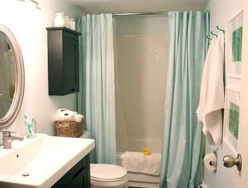 Treat your shower like a window with two curtains instead of one. Definitely my fav out of all these ideas!