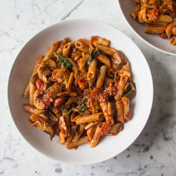 Simple tomato and mushroom pasta from Deliciously Ella - an easy midweek dinner with three portions of veg!