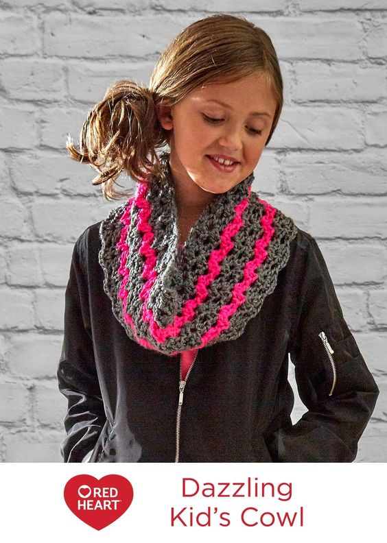 Dazzling Kid's Cowl Free Crochet Pattern in Red Heart Yarns -- This crocheted cowl adds a flash of fun to a kid's style! Everyone loves the way this yarn reflects the flash of a camera or other light at night.: