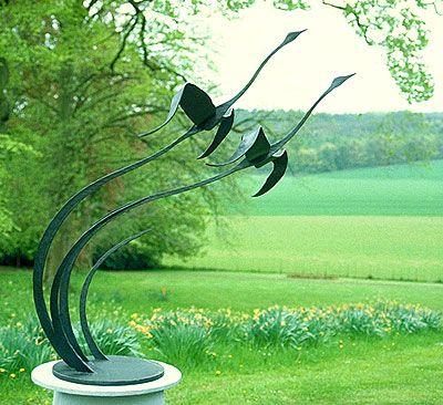 'garden sculpture of flying birds' (fantastic sculpture and photograph of sculpture!)