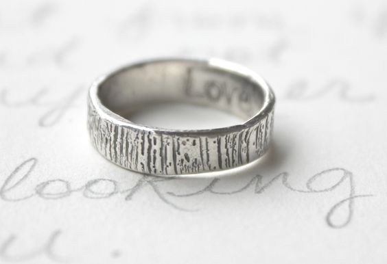 """men's woodgrain ring, with the word """"love"""" engraved inside"""