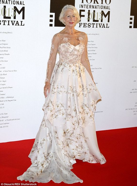 Belle of the ball: Dame Helen Mirren, 70, wowed in a white satin gown on the red carpet at the Tokyo International Film Festival opening ceremony on Thursday