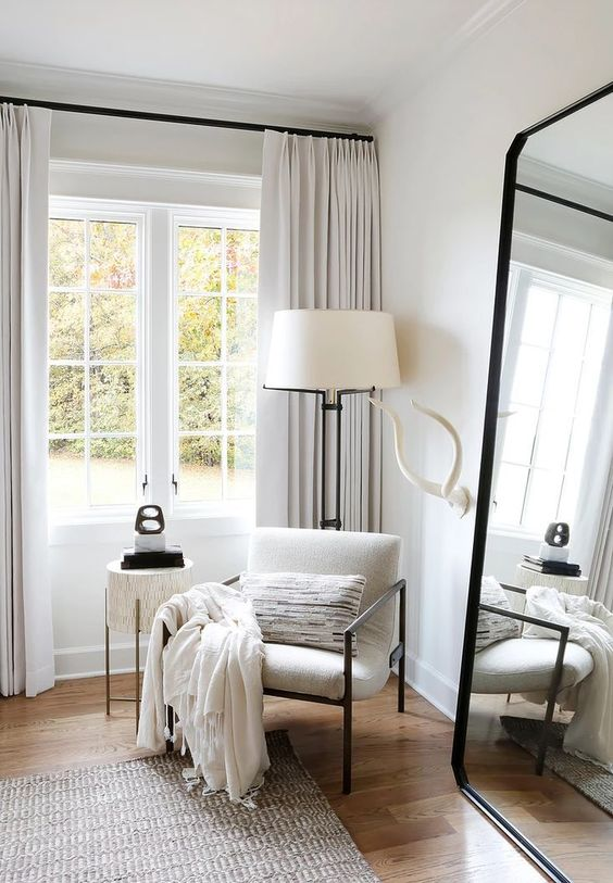 The cutest cozy corner in this bedroom with a leaner mirror  window  reading c