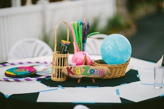 Include whimsy activities and crafts into your kids' table for an outdoor summer wedding reception, such as sidewalk chalk, silly straws, beach balls and glow sticks.