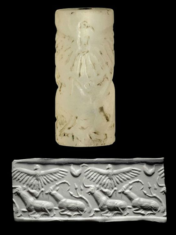 AN ELAMITE CHALCEDONY CYLINDER SEAL   CIRCA 3000-2800 B.C.   With recumbent bull and ibex one behind the other, stylized branch and bird in the field, an eagle with outstretched wings above with a U-shaped design between, with remains of bronze pin  1¼ in. (3.2 cm.) high