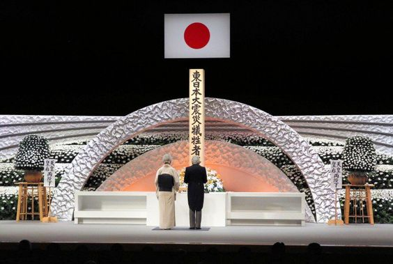 Emperor Akihito and Empress Michiko take part in a national memorial to honour the victims of the 2011 earthquake and tsunami.