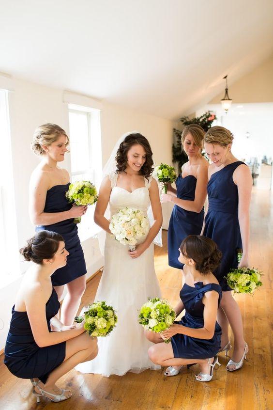 Navy bridesmaids dresses, green, yellow white flowers