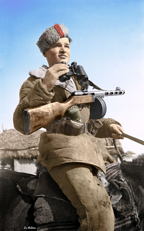 Soviet partisan on horseback in the countryside west of Kursk 1943