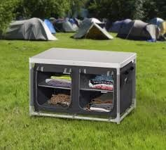 Mueble de camping.  Dispone de 4 compartimentos, se monta el cualquier terreno, patas ajustables. ¡Tus viajes más cómodos!
