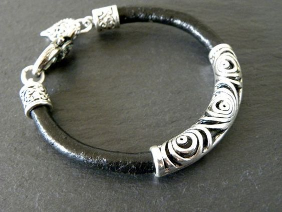Thick, black leather, beautiful silver filigree tube and silver clasp this bracelet is chic and modern. The bracelet is 8 long.  If you like it but need a different size send me a note and I would be happy to make you something special. Also available in natural and dark brown brown.