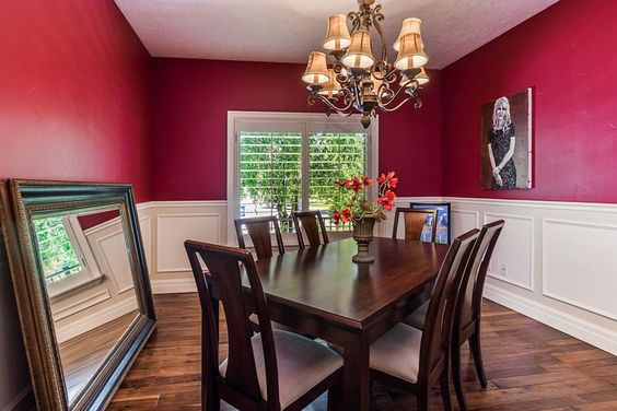 This dining room shows us how to use a strong color like red and still maintain a light look.