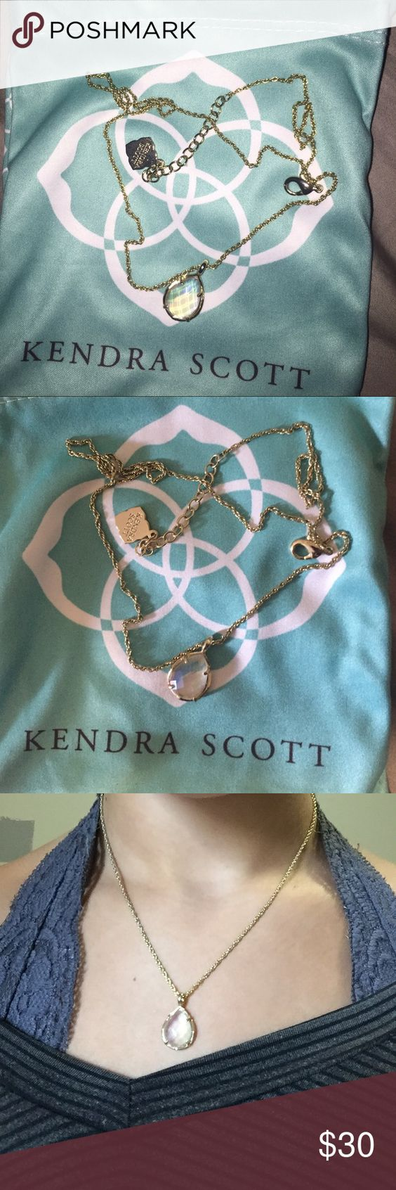 KENDRA SCOTT NECKLACE Clear (iridescent) kendra tear drop necklace! Not sure of the name. Beautiful necklace im just trying to downsize my kendra! In perfect condition. Modeled at its shortest length. Will come with dustbag. Kendra Scott Jewelry Necklaces
