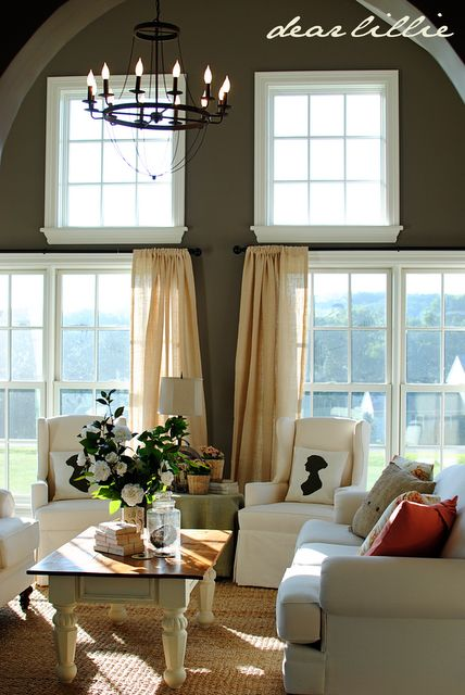 Paint color is Sparrow by Benjamin Moore.  Thinking about a dark grey on a wall with lots of windows like this one in new house.