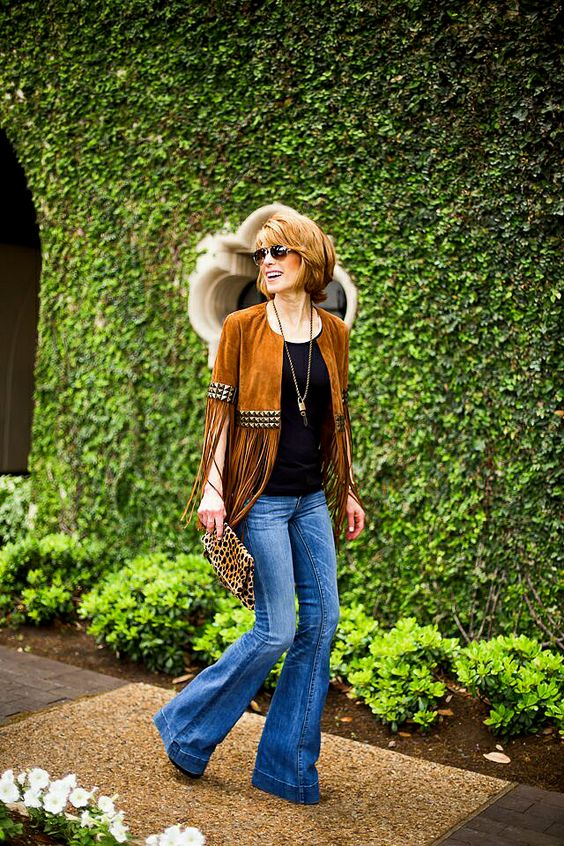 Cathy from The Middle Page in a suede fringe jacket.: