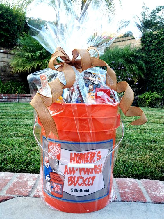 **House Warming Gift** * Home Depot 5-gallon bucket * level * hammer * stud finder * Phillips and flat head screw drivers * wall patch puddy * dry wall screws and nails * champagne, beer and pretzels