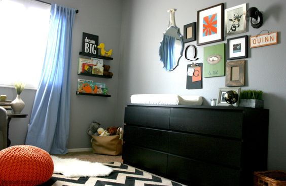 Eclectic, colorful gallery wall in the nursery - #nursery #gallerywall