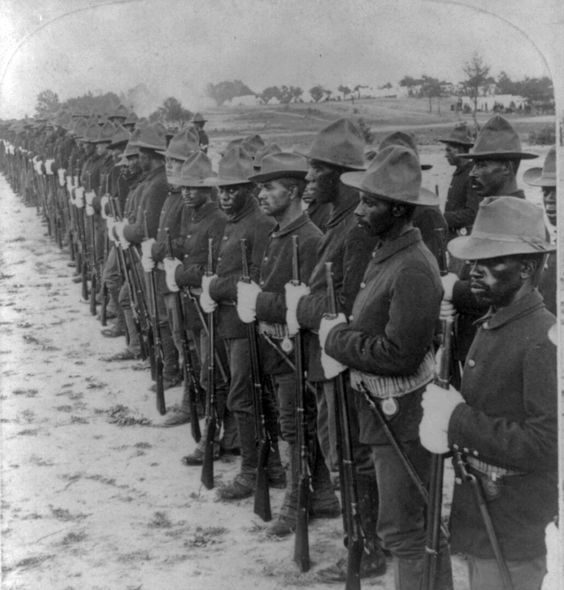Black soldiers in Spanish American War.   Historians say that the Buffalo Soldiers (blacks) charged San Juan Hill before Teddy Roosevelt but in that era it would be politically incorrect to give credits to the black soldiers.