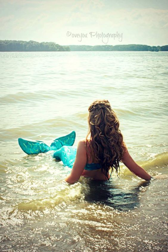 """When I was a child at my grandparent's lake house, I remember there being a yellow sign in the neighbor's yard by the dock saying, """"mermaid crossing."""" I looked for mermaids every time I was down on the dock."""