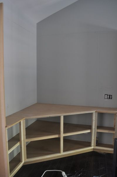corner built in for tv - Great way to make use of a corner space and still have shelving or drawers to keep DVD players, game consoles, games etc.