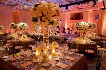 Don't be afraid to mix table shapes. This gorgeous reception has both round and square with the same elegant centerpieces~