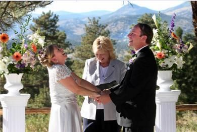 Denver wedding officiant Vicky Hampton officiating at Chief Hosa Lodge in Genesee Colorado