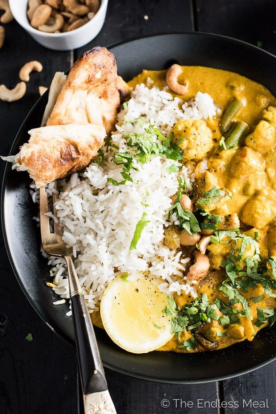 Creamy Coconut Vegetarian Korma | This easy to make and healthy Meatless Monday dinner recipe will be a hit at your table. It's a naturally paleo and gluten free Indian curry recipe that can easily be made vegan. | theendlessmeal.com